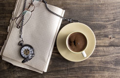 Vintage pocket watch with cup of coffee on old book Stock Photography