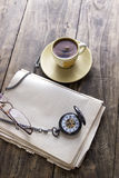 Vintage pocket watch with cup of coffee on old book Royalty Free Stock Image