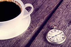Vintage pocket watch with cup of coffee Stock Photo