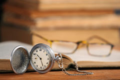 Vintage pocket watch glasses  and open old book Stock Photos