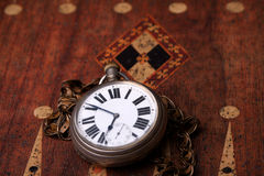 Vintage pocket watch on grunge backgorund Royalty Free Stock Images