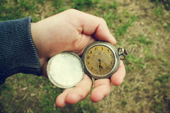 Vintage pocket watch in a man`s hand Royalty Free Stock Image