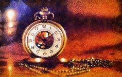 Vintage pocket watch near few lighting candles on dark backgroun Royalty Free Stock Photography