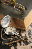 Vintage pocket watch old book and Brass Key Stock Photos