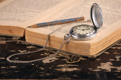 Vintage pocket watch old book brass key Stock Photos