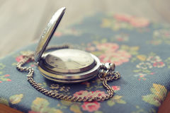 Vintage pocket watch. On old book closeup stock photo