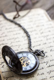 Vintage pocket watch on old book Royalty Free Stock Image