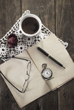 Vintage pocket watch, old book and coffee Royalty Free Stock Photo