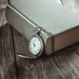 Vintage pocket watch on old books. Royalty Free Stock Image