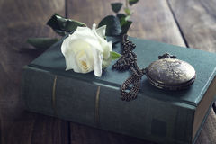 Vintage pocket watch on old books. Royalty Free Stock Photos