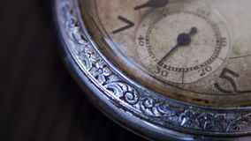 Vintage pocket watch. Old vintage clock mechanism watch time going fast,clock mechanism working.Antique clock dial close-up.Closeup shot with soft focus,A macro stock footage