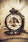 Vintage pocket watch on old map. Vintage clock on antique map. Geographical discovery concept Stock Photo