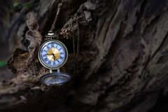 Vintage pocket watch on the old wooden background. With copy space royalty free stock images