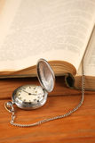 Vintage pocket watch and open old book Royalty Free Stock Photography
