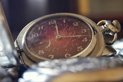 Vintage pocket watch with a red dial in retro style close up royalty free stock images