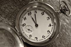 Vintage pocket watch on weathered wood background. Royalty Free Stock Image