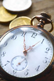 Vintage pocket watch on wooden background Royalty Free Stock Photos