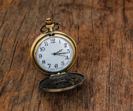 Vintage  pocket  watch   on wooden background Royalty Free Stock Images