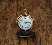 Vintage  pocket  watch   on wooden background Royalty Free Stock Photography