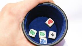 Vintage poker dice. And box over white felt Stock Photos