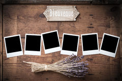 Vintage Polaroid photo frame on wood with lavender and sign stock photos