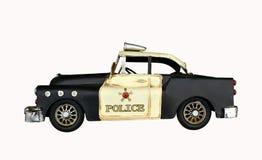 Vintage police car toy Stock Photos