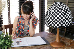 Vintage polka dot lamp with intentionally blurred working woman Stock Image