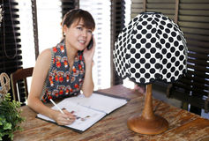 Vintage polka dot lamp with intentionally blurred working woman Royalty Free Stock Photo