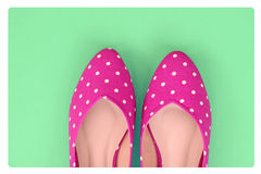 Vintage polka dot shoes on green background Royalty Free Stock Photography