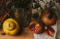 Vintage pomegranate and quince still life Royalty Free Stock Images
