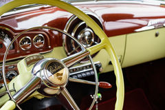 Vintage Pontiac Automobile. Miami, FL USA - March 12, 2017: Close up view of the interior of a beautifully restored vintage 1950 Pontiac automobile at a public stock photos
