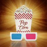 Vintage popcorn and 3D anaglyph glasses on grungy background. 3D illustration.  Royalty Free Stock Photo