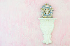Vintage porcelain clock against a pink background. Copy space. Royalty Free Stock Photography
