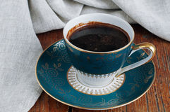 Vintage Porcelain Czech Republic Coffee Cup. On wooden table Royalty Free Stock Photography