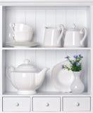Vintage porcelain tableware. White shelf with vintage porcelain tableware Stock Image