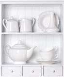 Vintage porcelain tableware. White shelf with vintage porcelain tableware Royalty Free Stock Photo