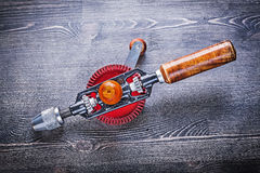 Vintage portable drill on wooden board Stock Images