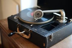 Vintage portable Gramophone Victrola with spinning record Royalty Free Stock Photo