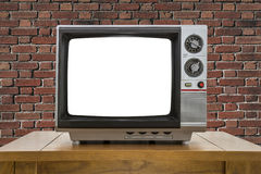 Vintage Portable Television with Red Brick Wall and Cut Out Screen Royalty Free Stock Images