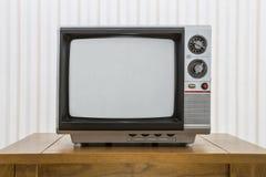 Vintage Portable Television on Table. Vintage portable television set on a old craftsman style table Stock Photo