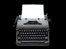 Vintage portable typewriter, isolated. Old fashioned, vintage typewriter with a blank sheet of paper inserted, isolated with clipping path Royalty Free Stock Images