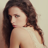 Vintage portrait of alluring beautiful young woman Stock Photos