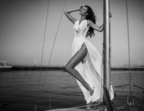 Vintage portrait of beautiful elegant woman in luxury long dress. Standing on the yacht. High fashion photo Royalty Free Stock Photo