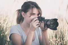 Vintage portrait of a beautiful young woman who likes to take pictures of nature royalty free stock photos