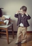 Vintage portrait of boy playing with old glasses Royalty Free Stock Photos