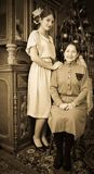Vintage portrait of daughter with mother Royalty Free Stock Photos