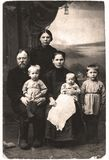 Vintage portrait of family. Portrait of a family of six men in the early 1920s. Sepia-toned desaturated color file stock photo