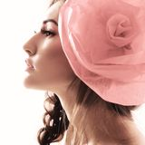 Vintage portrait of fashion glamour girl with red flower in her. Hair. Studio shot Stock Photo