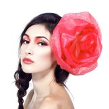 Vintage portrait of fashion glamour girl with red flower in her. Hair, over white. Studio shot Stock Photos