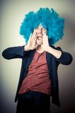 Vintage portrait of fashion guy with curly blue wig Stock Photos